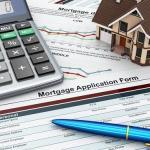Mortgage application form with a calculator and house