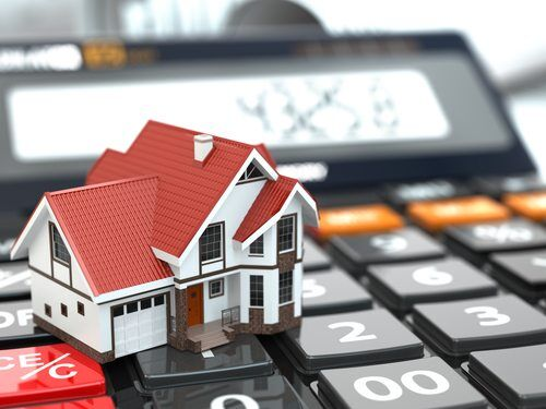 Real estate concept with house on calculator