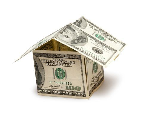 house made of $100 dollar bills isolated on white background