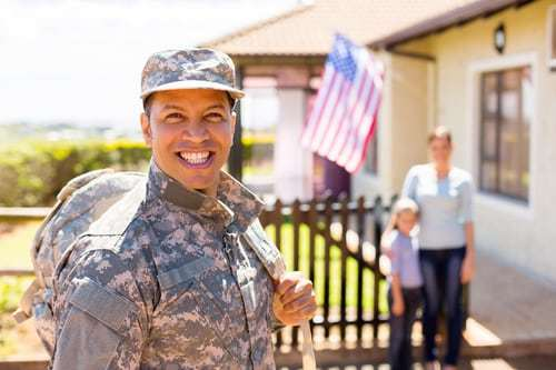 happy soldier returning home with house and family in background