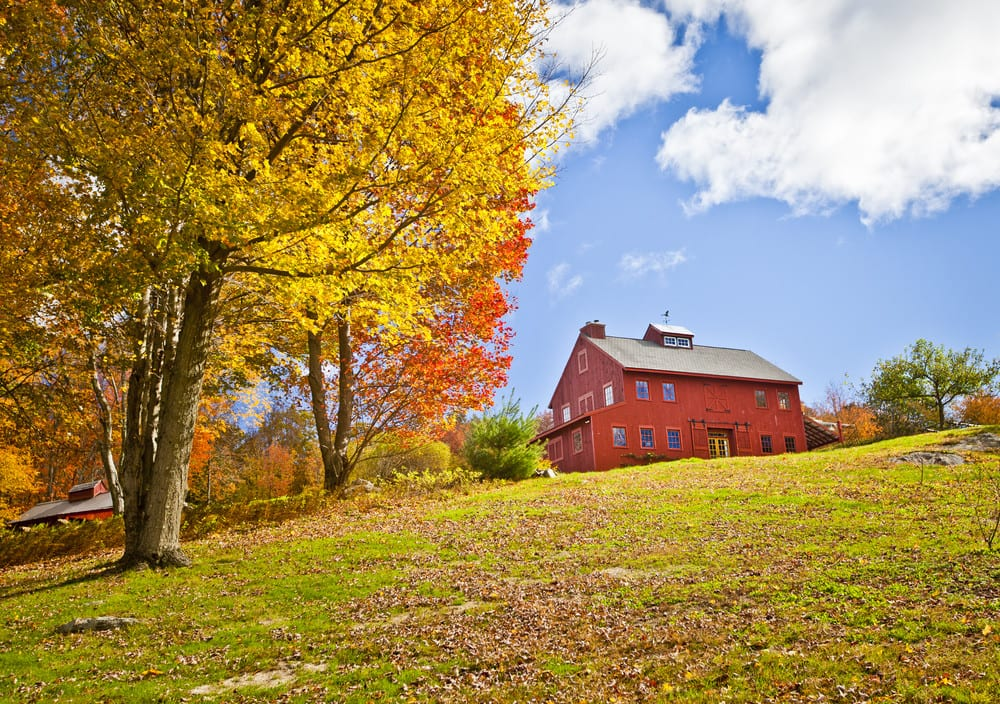 Beautiful red home in the country in the fall