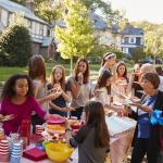 Neighbors of all ages eating food at a block party
