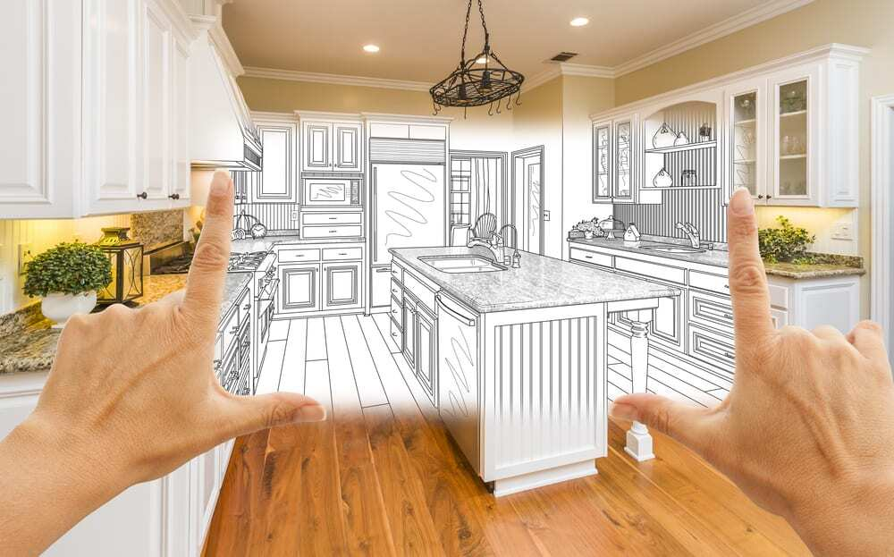 Photo of lovely kitchen, blends into drawing in the center, two hands framing the inspiration