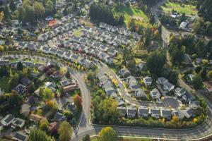 aerial view of suburban neighborhood on sunny day