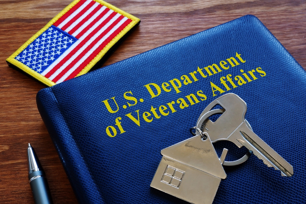 US Department of Veterans Affairs book, house key, American flag patch