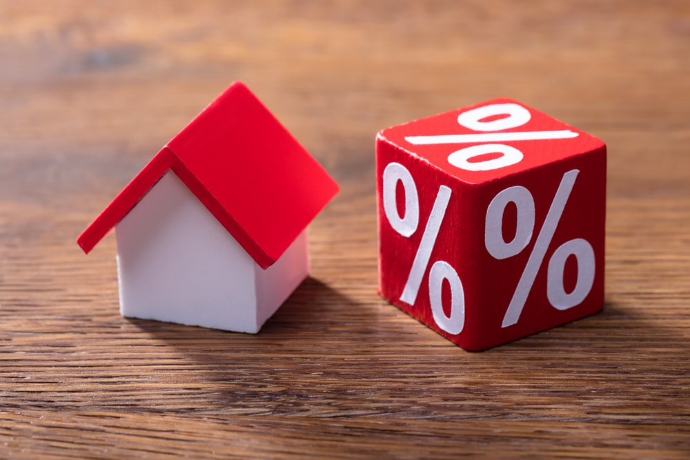 Little house model and dice with percentage symbol on all sides